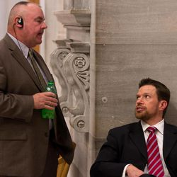 National Rifle Association lobbyist Darren LaSorte, right, speaks with Democratic Rep. Eddie Bass of Prospect outside the House chamber in Nashville, Tenn., on Monday, April 23, 2012. Bass is the main House sponsor of an NRA-back bill to guarantee workers' rights to store firearms in cars parked on company lots, regardless of their employers' wishes.