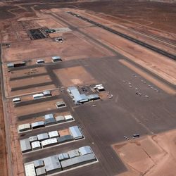 An aerial view shows the St. George Municipal Airport Tuesday, July 17, 2012.  A SkyWest Airlines employee wanted in a murder case attempted to steal a passenger plane, then shot himself in the head after crashing the aircraft in a nearby parking lot, officials said Tuesday. Brian Hedglin, 40, scaled a razor wire fence at the St. George Municipal Airport early Tuesday, then boarded the 50-passenger SkyWest jet while the airport was closed, St. George city spokesman Marc Mortenson said.