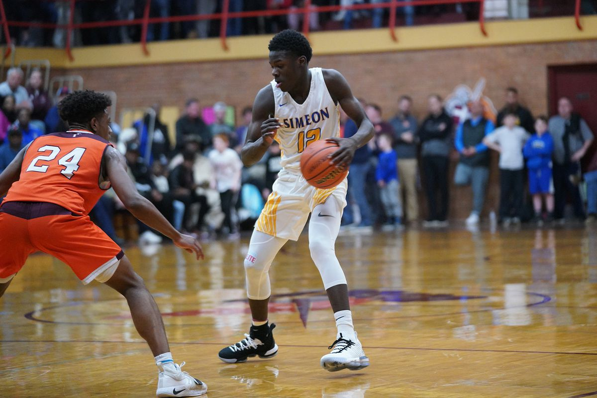 Simeon's Ahamad Bynum (12) switches direction against Brother Rice's Marquise Kennedy (24).