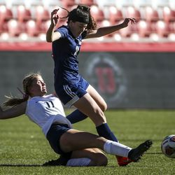 Bonneville's Gabby Carlson (11) kicks the ball away from Skyline's Rozlin Gomez (30) during the second half of the 5A girls state championship at Rio Tinto Stadium in Sandy on Friday, Oct. 25, 2019. Skyline defeated Bonneville in overtime 2-1 to take home the state title.