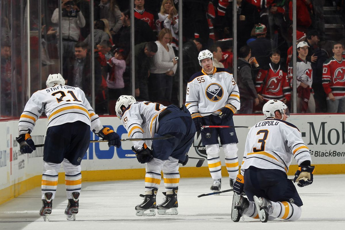 NEWARK, NJ - DECEMBER 28: The Buffalo Sabres linger on the ice following a 3-1 loss to the New Jersey Devils at the Prudential Center on December 28, 2011 in Newark, New Jersey.  (Photo by Bruce Bennett/Getty Images)