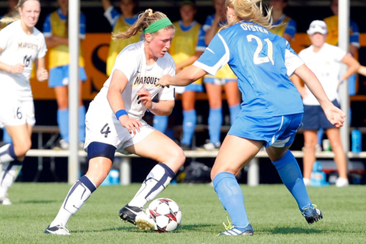 Maegan Kelly and Marquette have the challenge of keeping Rachel Daly out of the net.
