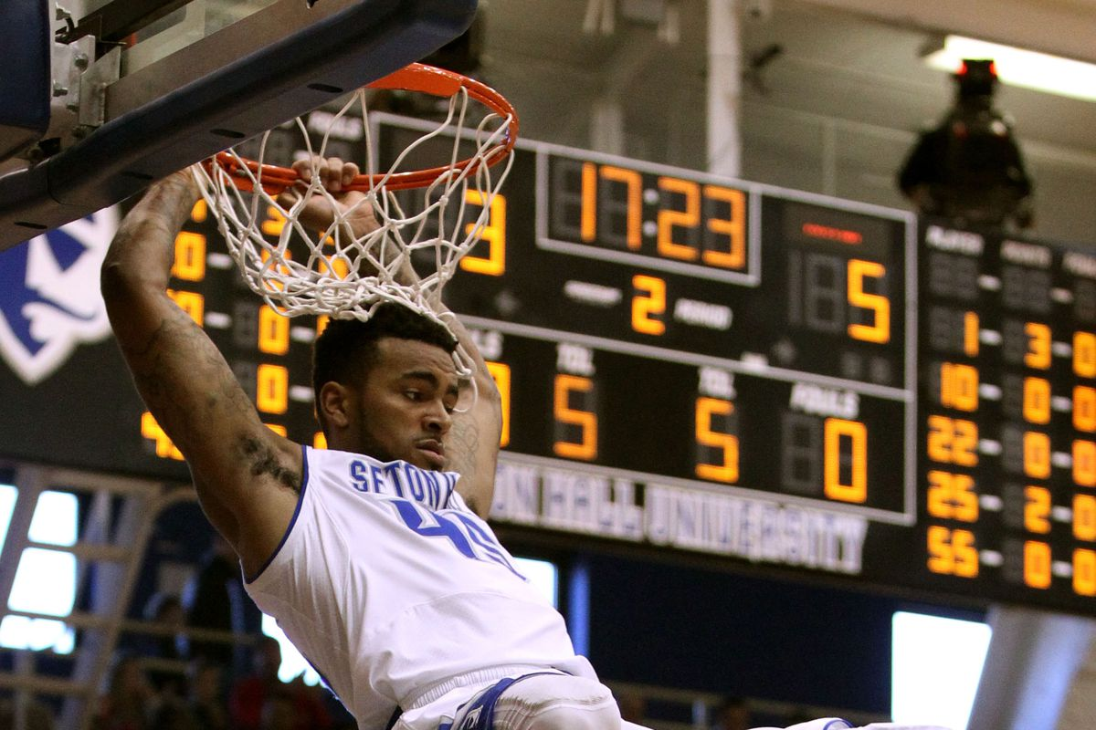 Stephane Manga goes up for a dunk against Maine at Walsh Gym.