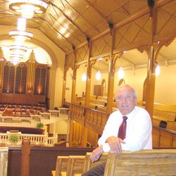 LDS Church leader Frank Crawford sits in the refurbished Bear Lake Tabernacle in Paris, Idaho, built in 1888 and rededicated after being fitted with air conditioning, heating, along with new wiring, windows and exterior doors.