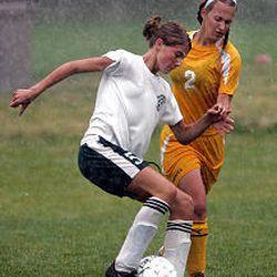 Olympus's Rachel Perkins tries to get past Cyprus's Kortine Jenkins in Tuesday's game.