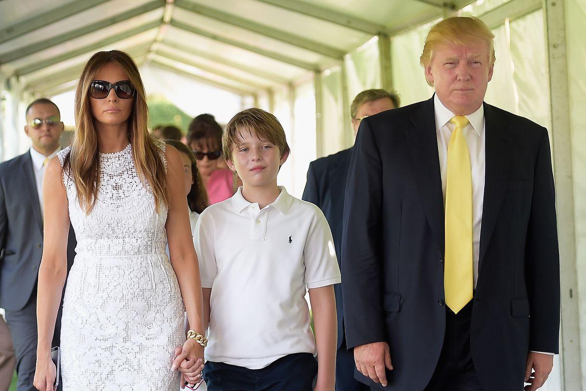 Melania Trump, Barron Trump, and Donald Trump at the Mar-a-Lago Club.