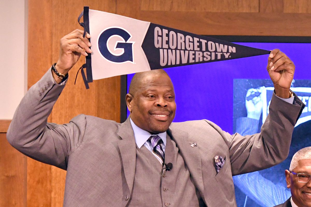 Patrick Ewing holds a Georgetown University pennant over his head
