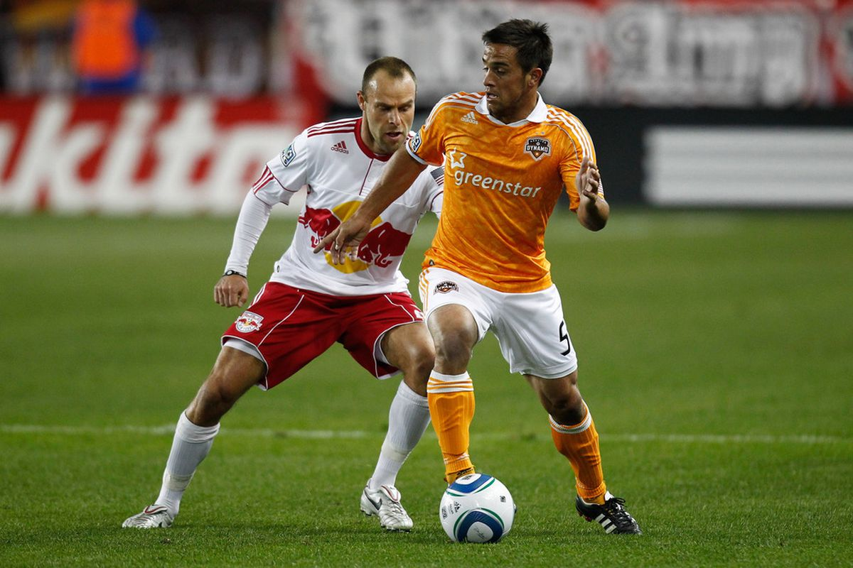 HARRISON, NJ - APRIL 02:  Danny Cruz #5 of the Houston Dynamo controls the ball against Joel Lindpere #20 of the New York Red Bulls at Red Bull Arena on April 2, 2011 in Harrison, New Jersey.  (Photo by Jeff Zelevansky/Getty Images)