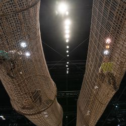 Kids climb through a rope bridge in the children's area of the 2020 Chicago Auto Show Saturday at McCormick Place.