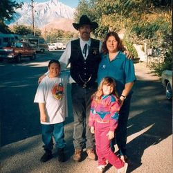 A young Sarah Robles, front right, and her brother, Glen, left, stand next to their father, Dennis, and mother, Joy.