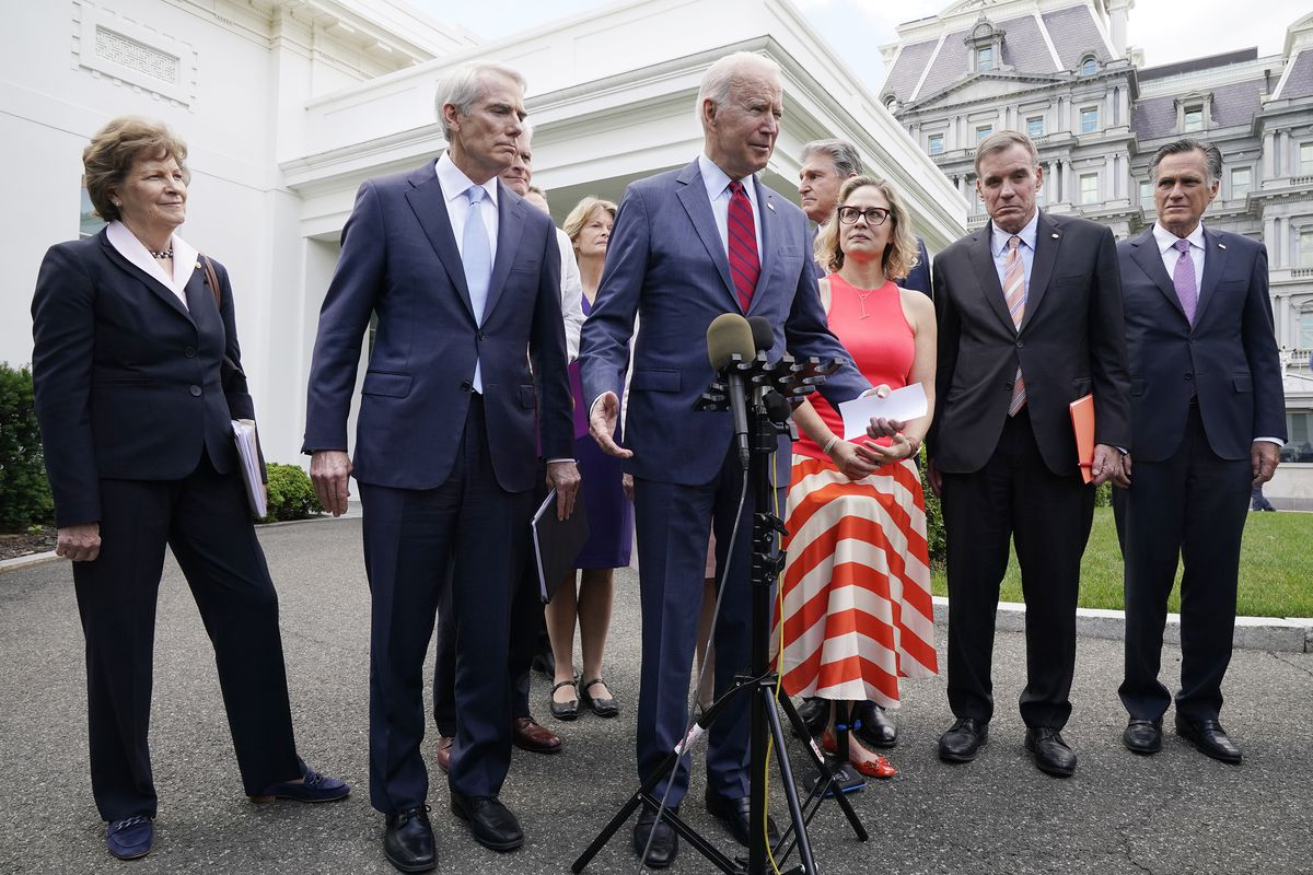 President Joe Biden, with a bipartisan group of senators, speaks outside of the White House in Washington.