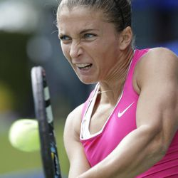 Sara Errani of Italy returns a ball against Nadia Petrova of Russia during her quarter-final match of the Pan Pacific Open Tennis in Tokyo Thursday, Sept. 27, 2012.