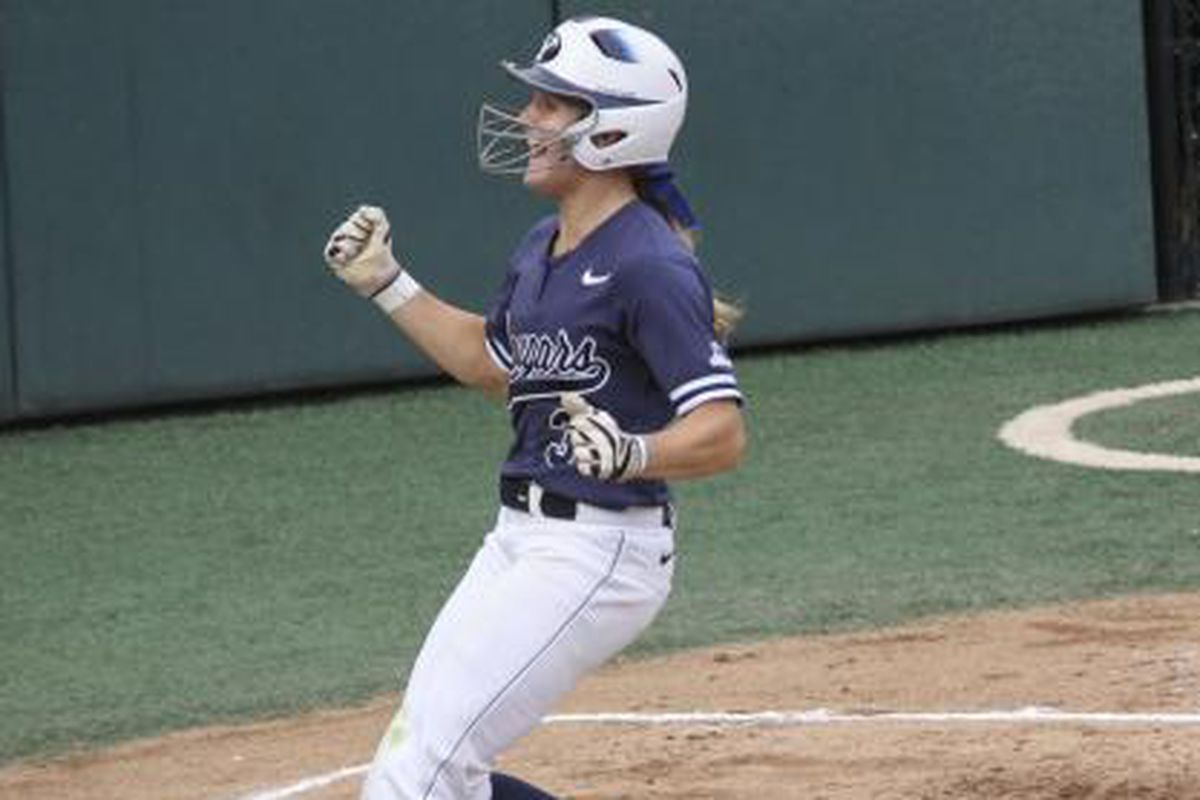 Carly Duckworth crosses home plate against Northwestern