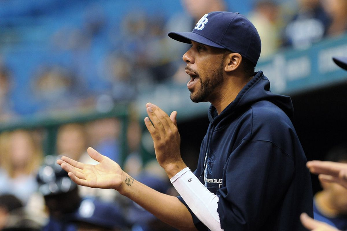 ST. PETERSBURG, FL - MAY 3: Pitcher David Price #14 of the Tampa Bay Rays cheers during a game against the Seattle Mariners May 3, 2012  at Tropicana Field in St. Petersburg, Florida.  (Photo by Al Messerschmidt/Getty Images)