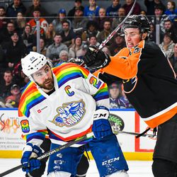 Syracuse Crunch Luke Witkowski (28) being checked by Lehigh Valley Phantoms Isaac Ratcliffe (19) in American Hockey League (AHL) action at the Upstate Medical University Arena in Syracuse, New York on Saturday, February 22, 2020. Syracuse won 2-1.