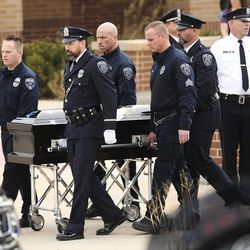 Herriman police K-9 Hondo's casket is moved during memorial services at Herriman High School in Herriman on Saturday, Feb. 29, 2020. The 7-year-old Belgian Malinois was shot and killed in the line of duty on Feb. 13 while trying to apprehend a wanted violent fugitive who was also shot and killed after officers say he displayed a gun.