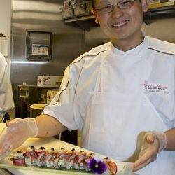 Social House executive chef John Chien Lee with the Ultimate Sushi Roll.