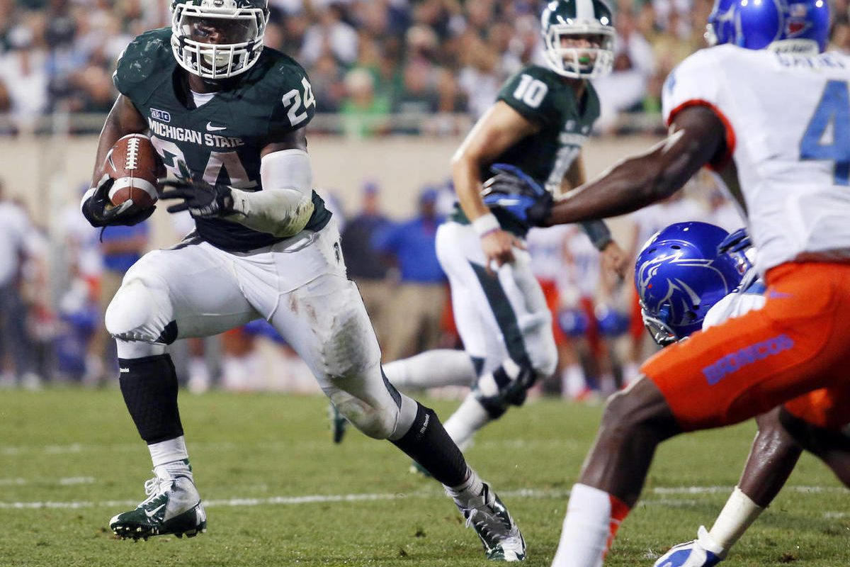 FILE - In this Aug. 31, 2012, file photo, Michigan State's Le'Veon Bell (24) gets past Boise State's Jerell Gavins (5) to score the game-winning touchdown during the fourth quarter of an NCAA college football game in East Lansing, Mich. Bell figured to ha