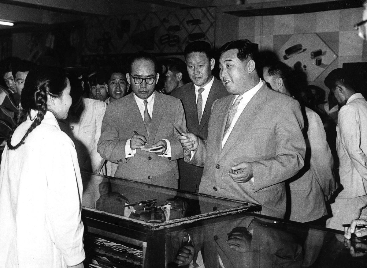 Kim Il Sung, the founder of North Korea and Kim Jong Un's grandfather, talks to a clerk at State Department Store No. 2 in April 1962.