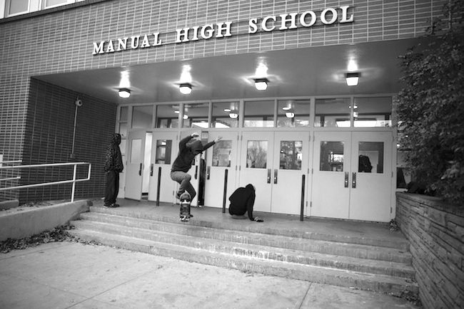 A Manual student skateboards across an entrance in December. Students are aware of how far behind they are, but constant 'nagging' has left many students uninterested in learning.