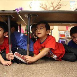 Diego Melendez Escobar, left, Emanuel Romero and Jonathan Sotelo Munoz, students in Danielle Wilson's kindergarten class, participate in an earthquake drill at Vista Elementary in Taylorsville, Tuesday, April 17, 2012. This was part of the Great Utah ShakeOut.