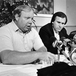 Larry H. Miller, left, came to the rescue of the Utah Jazz financially, buying the team from Sam Battistone, right.