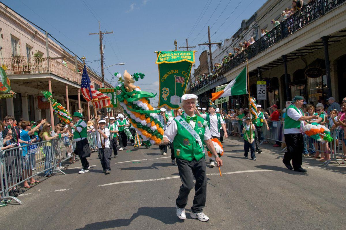 Members of the Corner Club parade down M