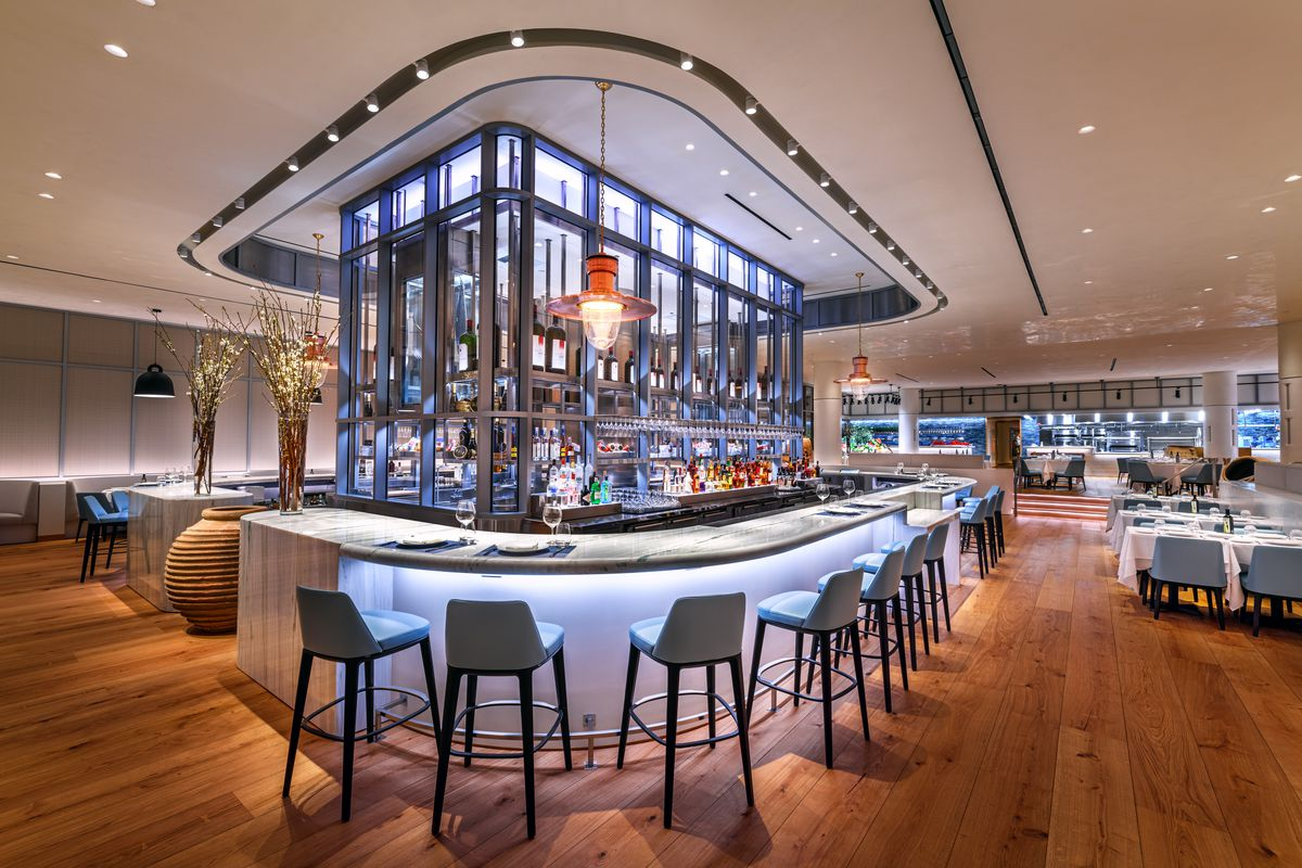 A well-lit bar in an opening dining room