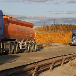In this Saturday, Sept. 10, 2011 photo, trucks carry oil near the town of Usinsk, 1500 kilometers (930 miles) northeast of Moscow. Komi is one of Russia's largest and oldest oil provinces but ruptures in aging pipelines and leaks from decommissioned oil wells make oil spills in the region routine. (AP Photo/Dmitry Lovetsky)
