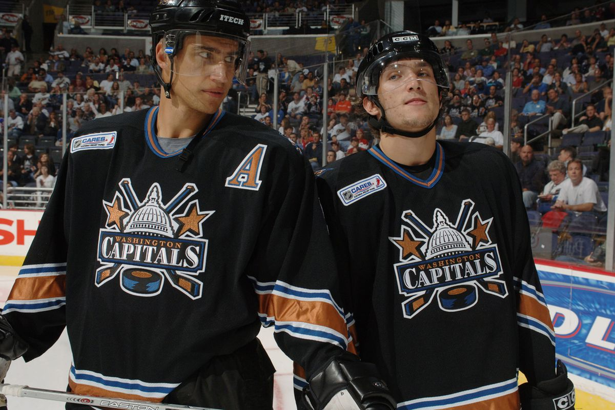 WASHINGTON - OCTOBER 5: Dainius Zubrus #9 and Alex Ovechkin #8 of the Washington Capitals on the ice during opening ceremonies against the Columbus Blue Jackets at MCI Center October 5, 2005 in Washington, DC. (Photo by Mitchell Layton/Getty Images)