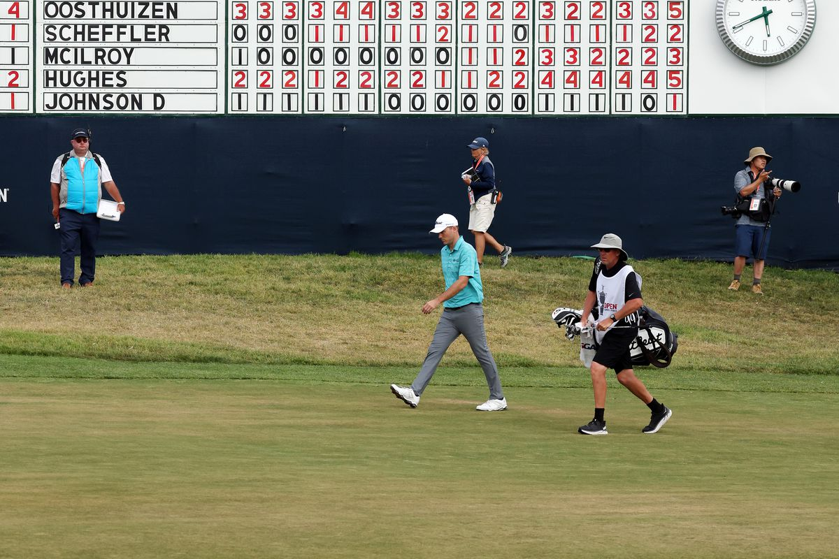 Russell Henley of the United States and his caddie walk the 18th fairway during the third round of the 2021 U.S. Open at Torrey Pines Golf Course (South Course) on June 19, 2021 in San Diego, California.