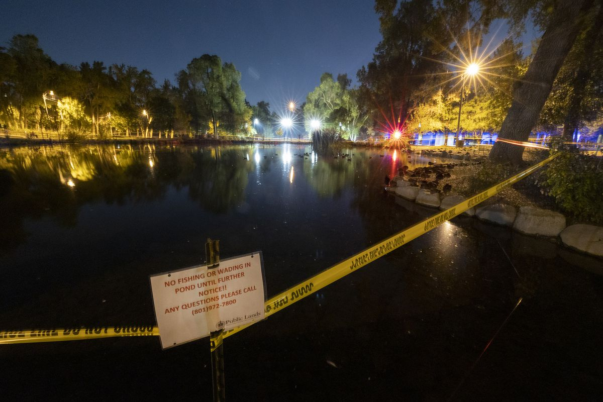 Fairmont Pond is surrounded by police tape and warning signs telling people not to fish or wade in the pond on Wednesday, Sept. 8, 2021.