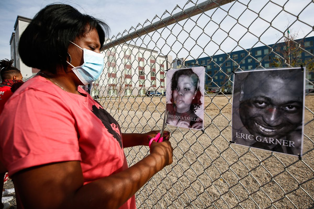 State Rep. Sandra Hollins displays a photograph at the Say Their Names Memorial in Salt Lake City on Saturday, Sept. 26, 2020.