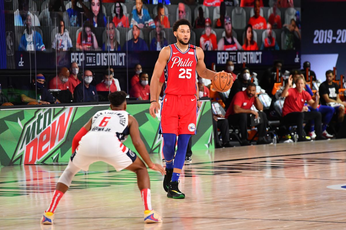 Ben Simmons of the Philadelphia 76ers handles the ball against the Washington Wizards on August 5, 2020 at The Arena at ESPN Wide World of Sports in Orlando, Florida.