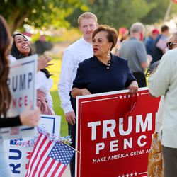 Supporters talk as they wait for Vice President Mike Pence to arrive in Salt Lake City on Monday, Oct. 5, 2020.