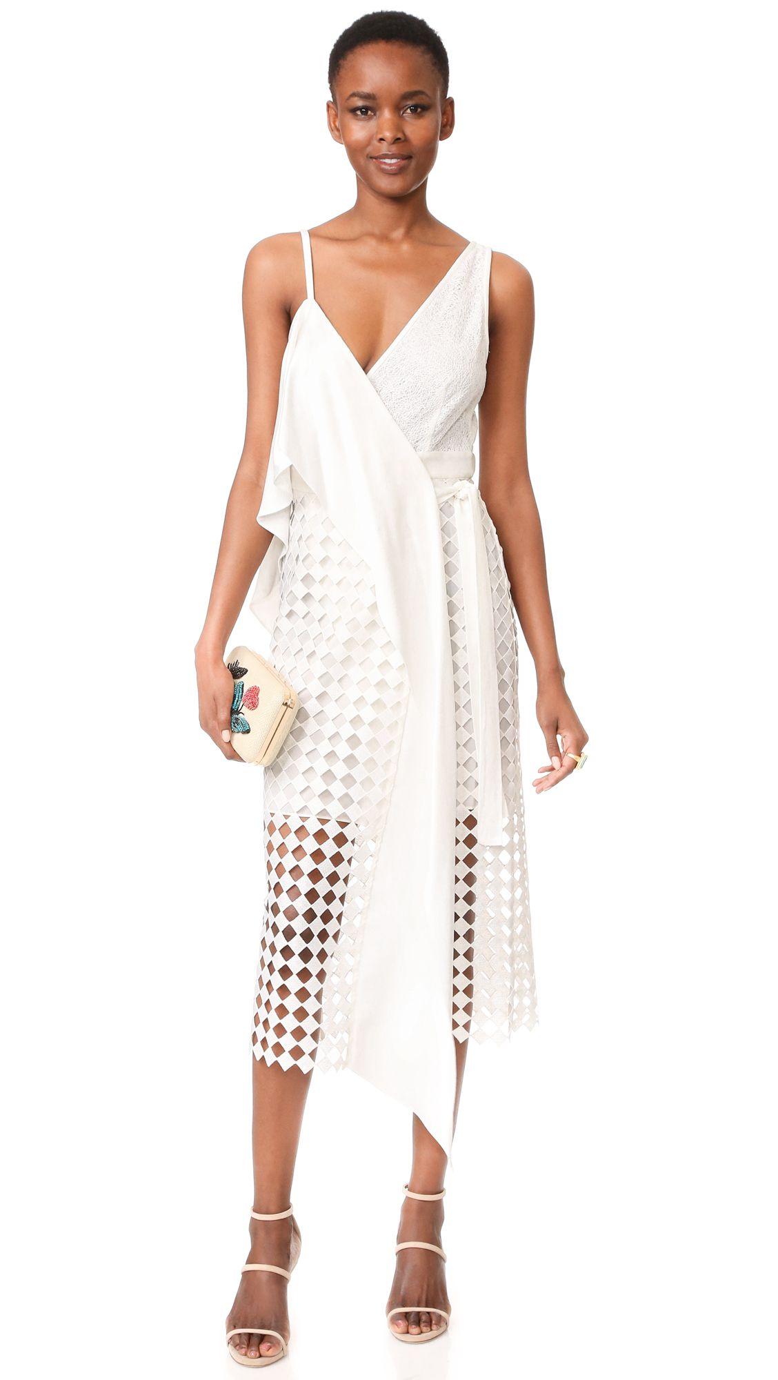 A model wearing a white cut out dress