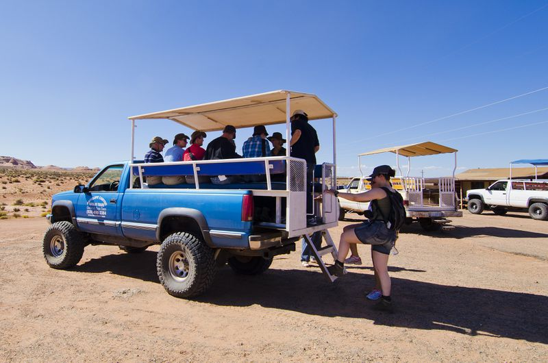 Visitors hop on a tour company truck to get to the mouth of Antelope Canyon.