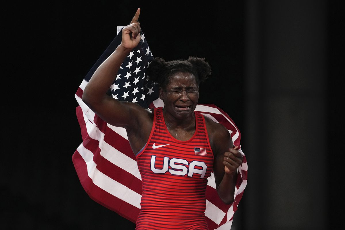 Tamyra Mensah-Stock holds the U.S. flag after winning Olympic gold in Tokyo.