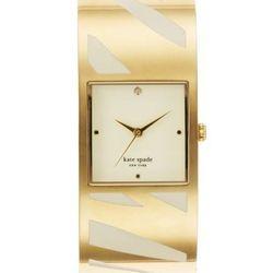 "Delacorte Bangle in gold/white zebra, <a href=""http://www.katespade.com/delacorte-bangle/1YRU0054,default,pd.html?dwvar_1YRU0054_color=780&start=8&cgid=watches"">$295</a>."