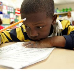 Second grade student Kaign Groce, 7, reads a book Wednesday, Feb. 1, 2006, during a literacy class at the John Fenwick Elementary School in Salem, N.J.