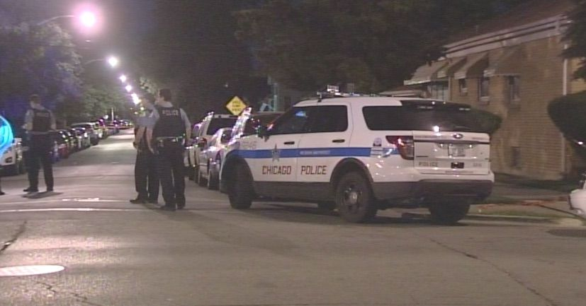 Officers block off a Belmont Central neighborhood block after a man was shot by a Chicago Police officer during a traffic stop early Sunday.   Network Video Productions