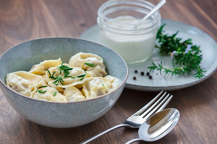 A bowl of Borsch Mobile's pelmeni, served with a sour cream and vinegar sauce instead of in a soup