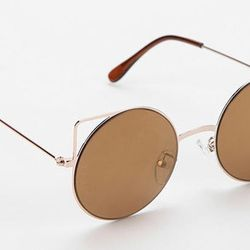 """Metal-Accented Round: <b>Urban Outfitters</b> Purr-Fect Metal Sunglasses, <a href=""""http://www.urbanoutfitters.com/urban/catalog/productdetail.jsp?id=27345586&parentid=W_ACC_SUNGLASSES"""">$18</a>"""