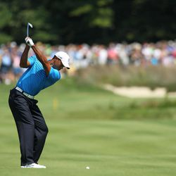 Tiger Woods hits his second shot on the second hole during the second round of the Deutsche Bank Championship PGA golf tournament at TPC Boston in Norton, Mass., Saturday, Sept. 1, 2012.