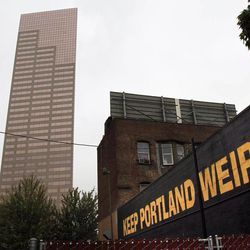 A downtown building sports a popular slogan in relation to the city in Portland, Ore., Wednesday, Sept. 19, 2012. Researchers at Portland State University found that the Portland atmosphere and culture is a magnet for the young and college educated, even though a disproportionate share of them are working in part-time jobs or positions that don't require a college degree.