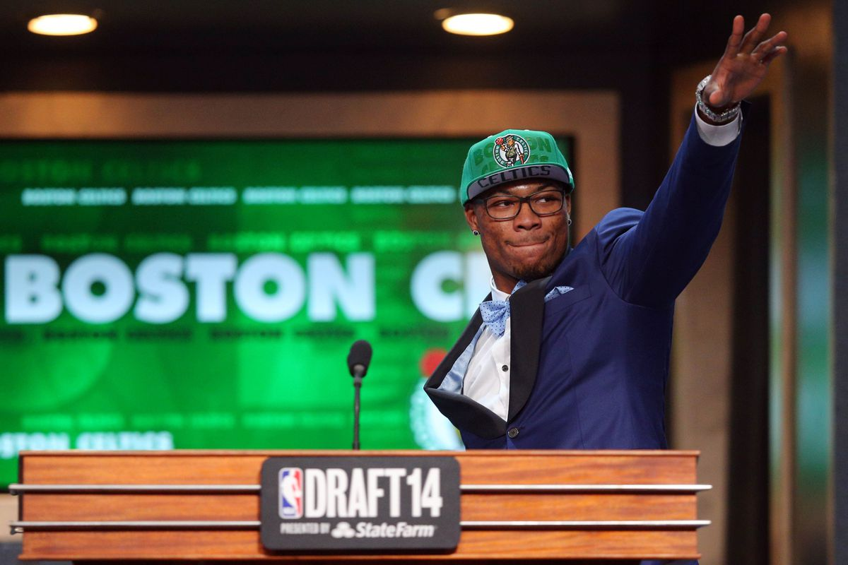 Marcus Smart walks across the stage and starts a new chapter.