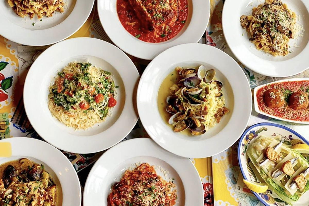 A collection of pasta dishes, meatballs, and other sides from Bizzarro Italian Cafe
