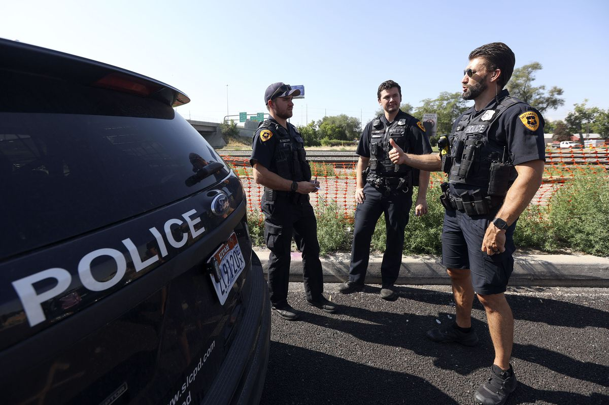 Salt Lake police officer-in-training Brenton Christian, left, Salt Lake police officer Christopher Berry and Salt Lake police officer Luke Johnson talk while responding to a trespassing call in Salt Lake City on Tuesday, Aug. 3, 2021. Salt Lake City police are now allowed to have beards after a policy change aimed to give police more flexibility and boost morale.