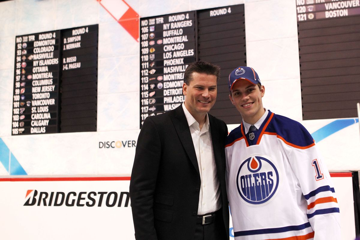 Former NHL player Craig Simpson and son 92nd overall pick Dillon Simpson by the Edmonton Oilers pose for a photo during day two of the 2011 NHL Entry Draft at Xcel Energy Center on June 25, 2011 in St Paul, Minnesota.