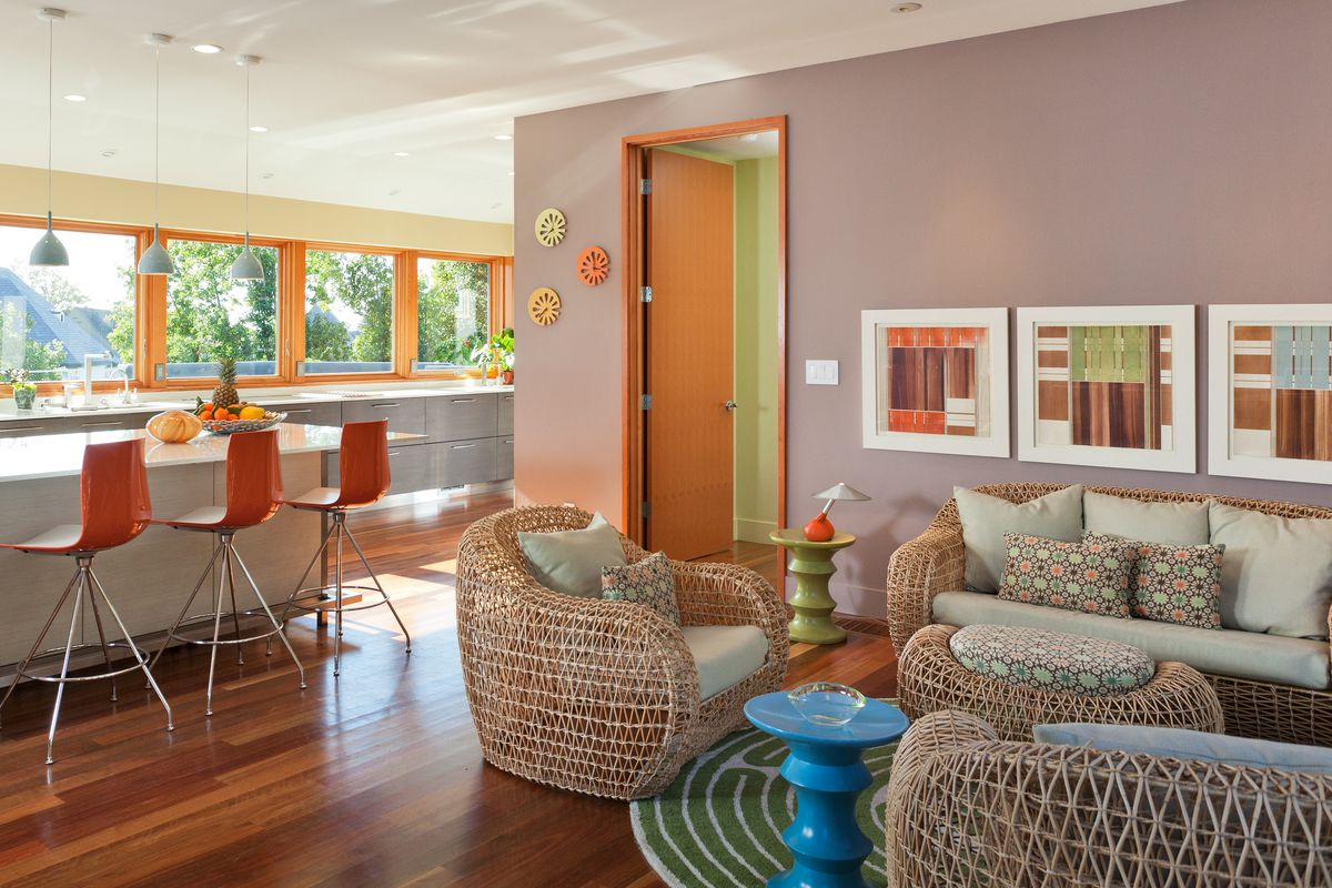 Room with blue-violet wall and orange-yellow accents.